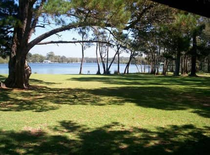 Kullindi Homestead's beautiful grounds on the banks of Sussex Inlet class=